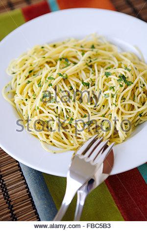 Traditional Italian dish, Spaghetti aglio e olio, served in a bowl - Stock Photo