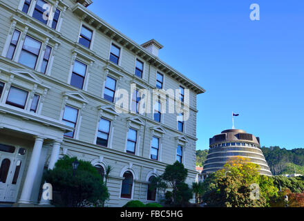 New Zealand's Old Government Building with the New Zealand's Parliament (Beehive) behind , in central Wellington - Stock Photo