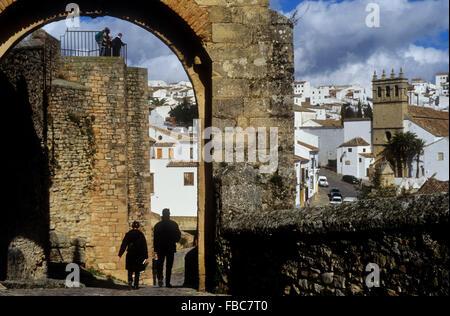 Arch of Felipe V. In Santo Domingo street. At background  convent of la Madre de Dios. Ronda. Málaga province, Spain - Stock Photo