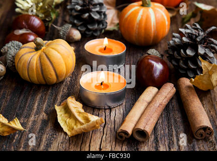 Fall Decoration with Pumpkins, Leaves,Candles, Cinnamon Sticks ,Chestnuts and Acorns - Stock Photo