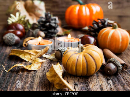Pumpkins Decoration with Candles, Leaves, Acorns.Thanksgiving,Halloween and Autumn Concept - Stock Photo
