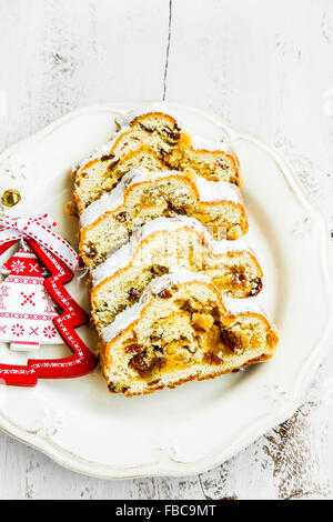 Christmas Cake ,Stolen Traditional Christmas Cake with Festive Ornaments - Stock Photo