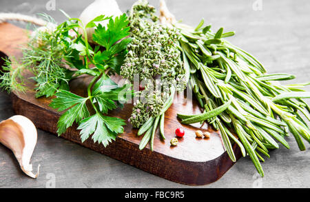Culinary Herbs with Parsley,Dill,Rosemary and Thyme on Wooden Board - Stock Photo