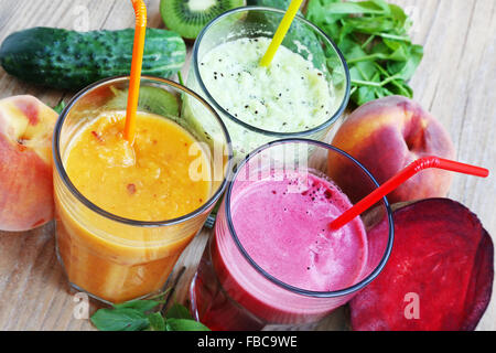 Fresh Detox Juices with Healthy Spinach and Kiwi, Beet and Peaches - Stock Photo