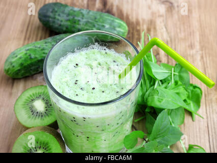 Healthy Green Detox Smoothie with Baby Spinach, Kiwi Fruits and Cucumbers - Stock Photo