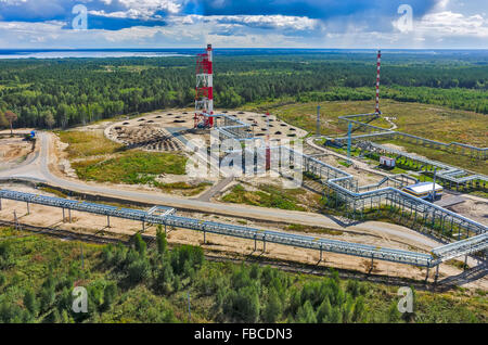 Torches for burning of associated gas of oil plant - Stock Photo