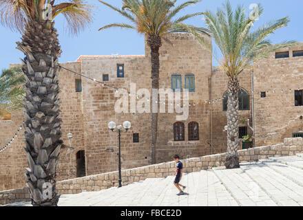 Jewish boy walking down steps in Jaffa old own Israel - Stock Photo