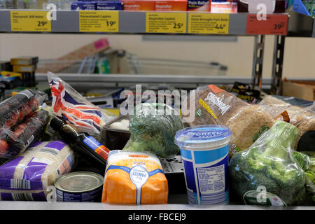 Aldi Supermarket products groceries on checkout counter at grocery store  in Wales UK   KATHY DEWITT