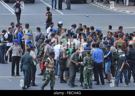 Jakarta, Indonesia. 14th Jan, 2016. Indonesian police officers take security measures near the location of explosions - Stock Photo