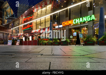 Night view of Chimichanga Mexican restaurant and Frankie and Bennys outside the Highcross shopping centre in Leicester - Stock Photo