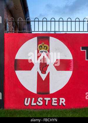 Northern Ireland flag painted on Loyalist East Belfast mural with word Ulster underneath. - Stock Photo