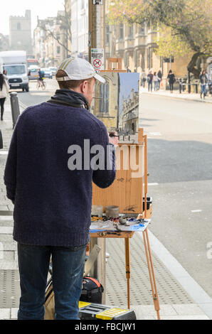 An artist painting Plein Air in High Street, Oxford, England, United Kingdom. - Stock Photo
