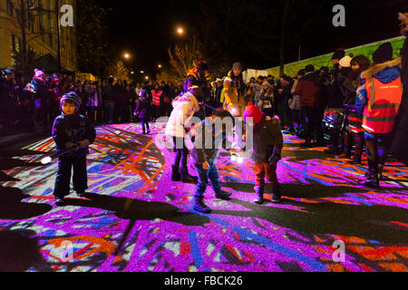 London, Uk. 14th January 2016. Children have fun painting light trails on the floor at the 'Light Graffiti' by Floating - Stock Photo