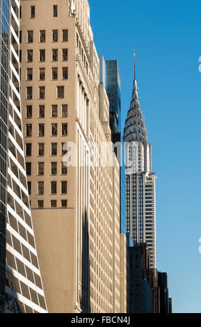 View looking along 42nd Street in NYC towards the Chrysler Building, an iconic art deco skyscraper and office building - Stock Photo