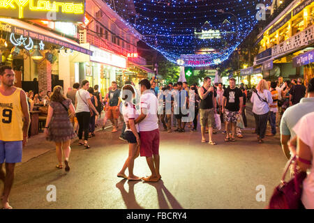 A couple have their photo taken in Pub Street in Siem Reap, Cambodia. - Stock Photo
