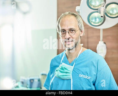 Vet, doctor in operating theatre with face mask around neck, Austria - Stock Photo