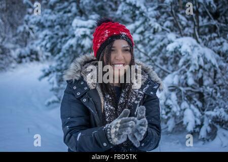 Woman Wearing Winter Gear In Snow - Stock Photo