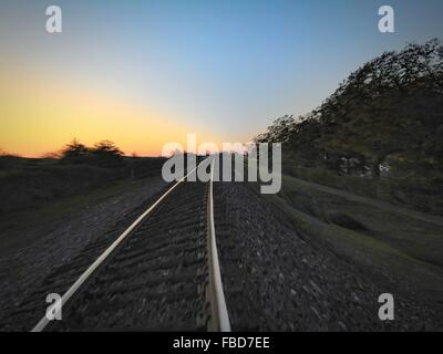 Railroad Track On Field Against Sky - Stock Photo