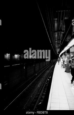 People At Railroad Station Platform - Stock Photo