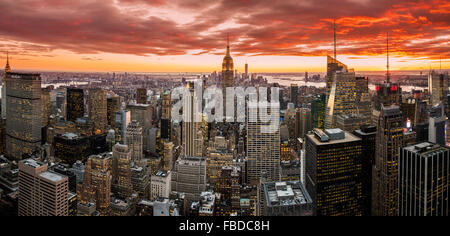 Panoramic view over Midtown Manhattan skyline at sunset from the Top of the Rock, New York, USA - Stock Photo