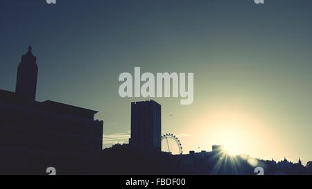 Low Angle View Of Silhouetted City Against Sky During Sunset - Stock Photo