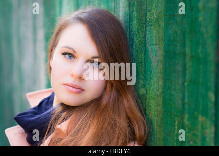 Close-Up Portrait Of A Serious Young Woman - Stock Photo