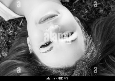 Close-Up Portrait Of A Smiling Young Woman - Stock Photo