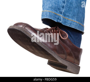 step of male left leg in jeans and brown shoe isolated on white background - Stock Photo