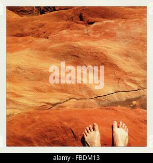 Feet Of Man On Rocks - Stock Photo