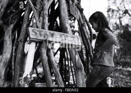 Girl Near Pile Of Wood - Stock Photo