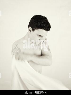 Man Wearing Shirt Against White Background - Stock Photo