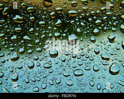 Close Up Of Rain Drops On Glass - Stock Photo