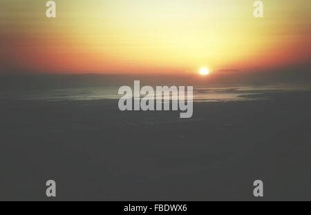 Scenic View Of Beach Against Sky At Sunset - Stock Photo