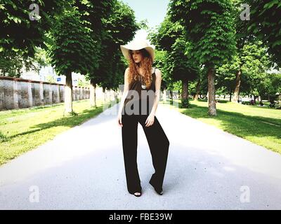Full Length Of Beautiful Woman Standing On Road - Stock Photo
