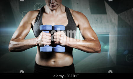 Composite image of muscular woman lifting heavy dumbbells - Stock Photo