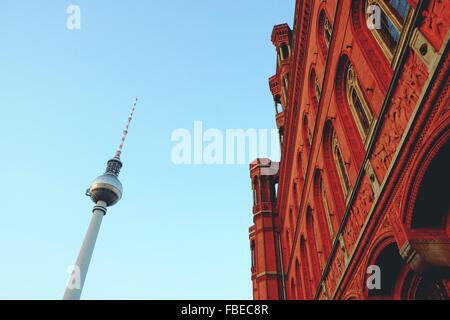 Low Angle View Of Fernsehturm Tower By Building Against Clear Sky - Stock Photo