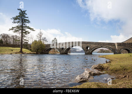 View of stone bridge over River Tay, (mouth of Loch Tay) at Kenmore A827, Perthshire, Scotland, UK, Europe. - Stock Photo