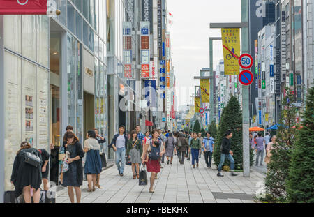 Tokyo Japan local crowds Ginza shopping area downtown with rush of locals and tourists shop and walk along famous - Stock Photo