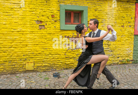 Buenos Aires Argentina La Boca tango dance with couple on street with colors worn walls with passion model released - Stock Photo