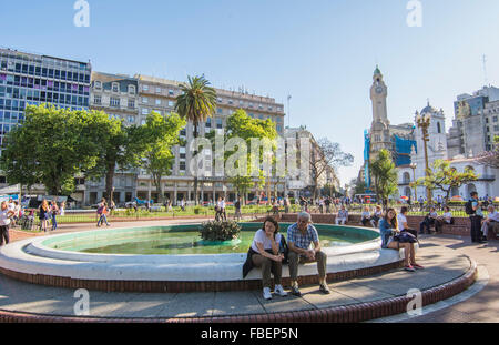 Buenos Aires Argentina Plaza de Mayo people sitting on fountain in main square of city center - Stock Photo