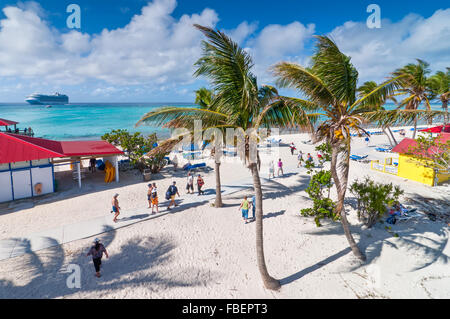 Tourists enjoy a sunny day on the sandy beach of Princess Cays, Eleuthera in the Bahamas - Stock Photo