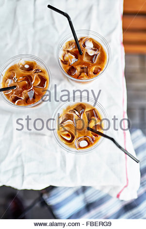 Three cups of iced coffee outdoor top view - Stock Photo