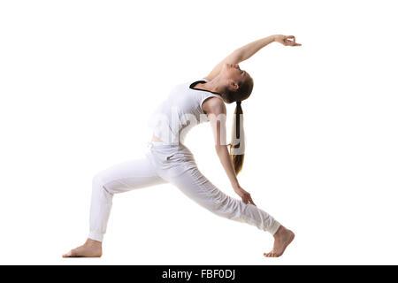 Athletic female practices yoga pose Stock Photo: 82214420 ...