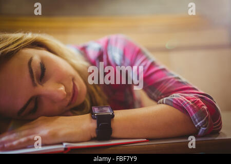 Attractive student sleeping during class - Stock Photo