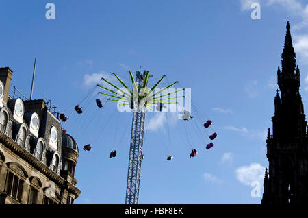 People on the Star Flyer ride, next to the Scott Monument in Princes Street, Edinburgh, Scotland. - Stock Photo