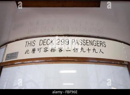 SIGN 299 PASSENGERS ON DECK Star FERRY  FERRYBOAT Hong Kong Island Kowloon and Victoria Harbour, Hong Kong China - Stock Photo