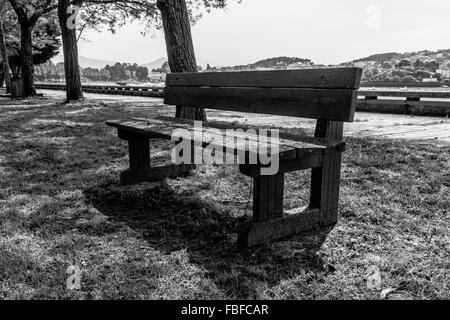 View Of Wooden Bench In Park - Stock Photo
