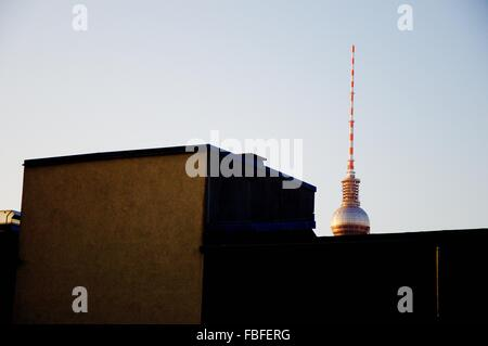 Low Angle View Of Fernsehturm And Building Against Clear Sky - Stock Photo