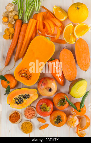 Orange coloured fruit and vegetables - Stock Photo