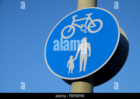 Shared Path sign against a blue sky in the UK - Stock Photo